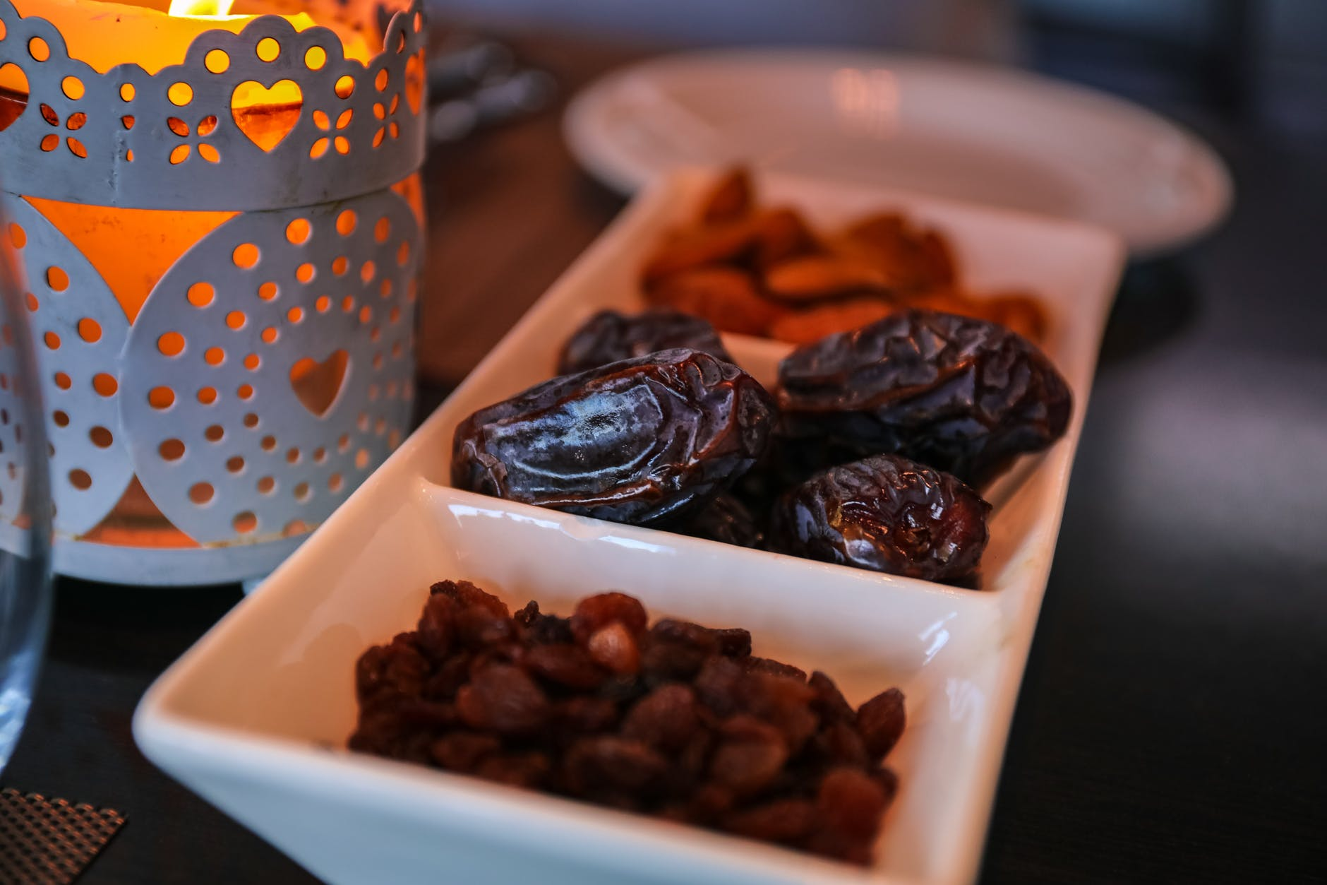 close up photo of raisins and dates